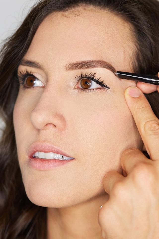 "<p>The dual-ended Benefit Brow Styler features both wax pencil and loose filling powder, and you'll want to use both ends for this look. ""Use the wax pencil to sketch out the outline of your brows, and don't be afraid to extend them a bit longer than where your brows naturally end,"" he said. Once you have your outline, fill in your brows with the powder end using the special flocking tip. Its shape and texture allow you to ruffle the product into your brows using forward and backward motions, and the <a href=""https://www.popsugar.com/beauty/Benefit-Cosmetics-Foolproof-Brow-Powder-43961246"" class=""ga-track"" data-ga-category=""Related"" data-ga-label=""https://www.popsugar.com/beauty/Benefit-Cosmetics-Foolproof-Brow-Powder-43961246"" data-ga-action=""In-Line Links"">powder formula</a> will adhere to your skin and hairs so you won't experience fallout.""</p>"