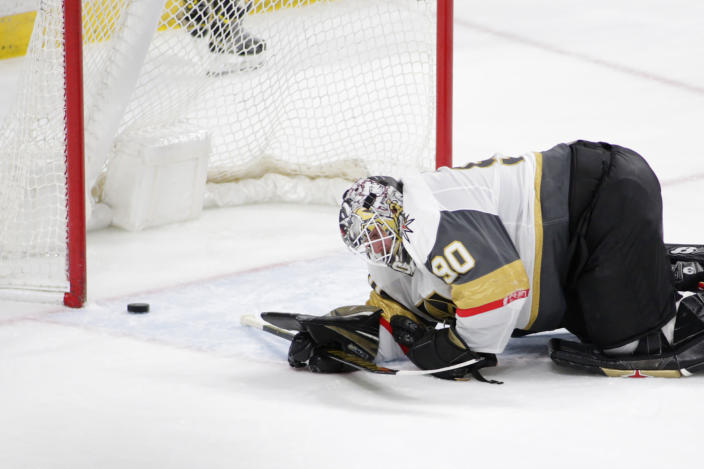 Vegas Golden Knights goaltender Robin Lehner reacts after a goal was scored by Minnesota Wild left wing Kirill Kaprizov (97) in the third period during an NHL hockey game, Monday, May 3, 2021, in St. Paul, Minn. (AP Photo/Andy Clayton-King)