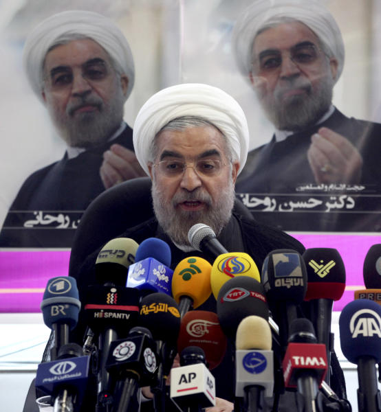 Iranian presidential candidate Hasan Rowhani, a former top nuclear negotiator, speaks at a press conference at his campaign headquarters in Tehran, Iran, Saturday, June 1, 2013. The 11th presidential election after Iran's 1979 Islamic Revolution, will be held on June 14. (AP Photo/Vahid Salemi)