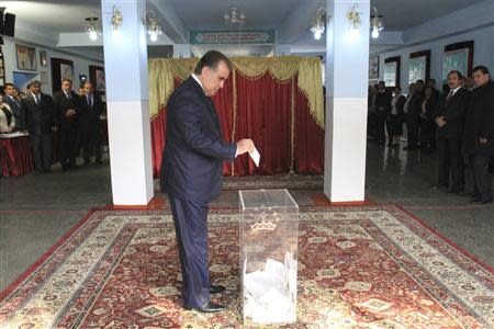 Tajikistan's President Imomali Rakhmon casts his ballot during the presidential election in Dushanbe