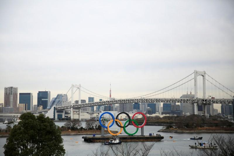 Giant Olympic rings installed as Tokyo enters final stretch