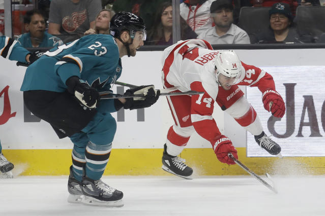 Detroit Red Wings center Robby Fabbri (14) gets caught by the stick of San Jose Sharks center Barclay Goodrow (23) during the second period of an NHL hockey game in San Jose, Calif., Saturday, Nov. 16, 2019. (AP Photo/Jeff Chiu)