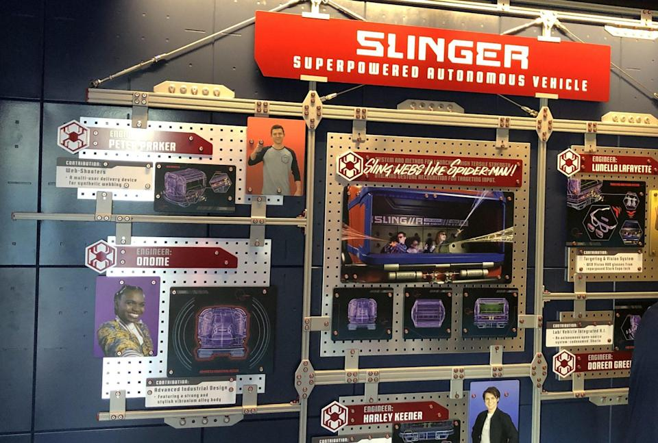 The wall upon entering the line queue at WEB Slingers: A Spider-Man Adventure, showing the young engineers of Stark industries.