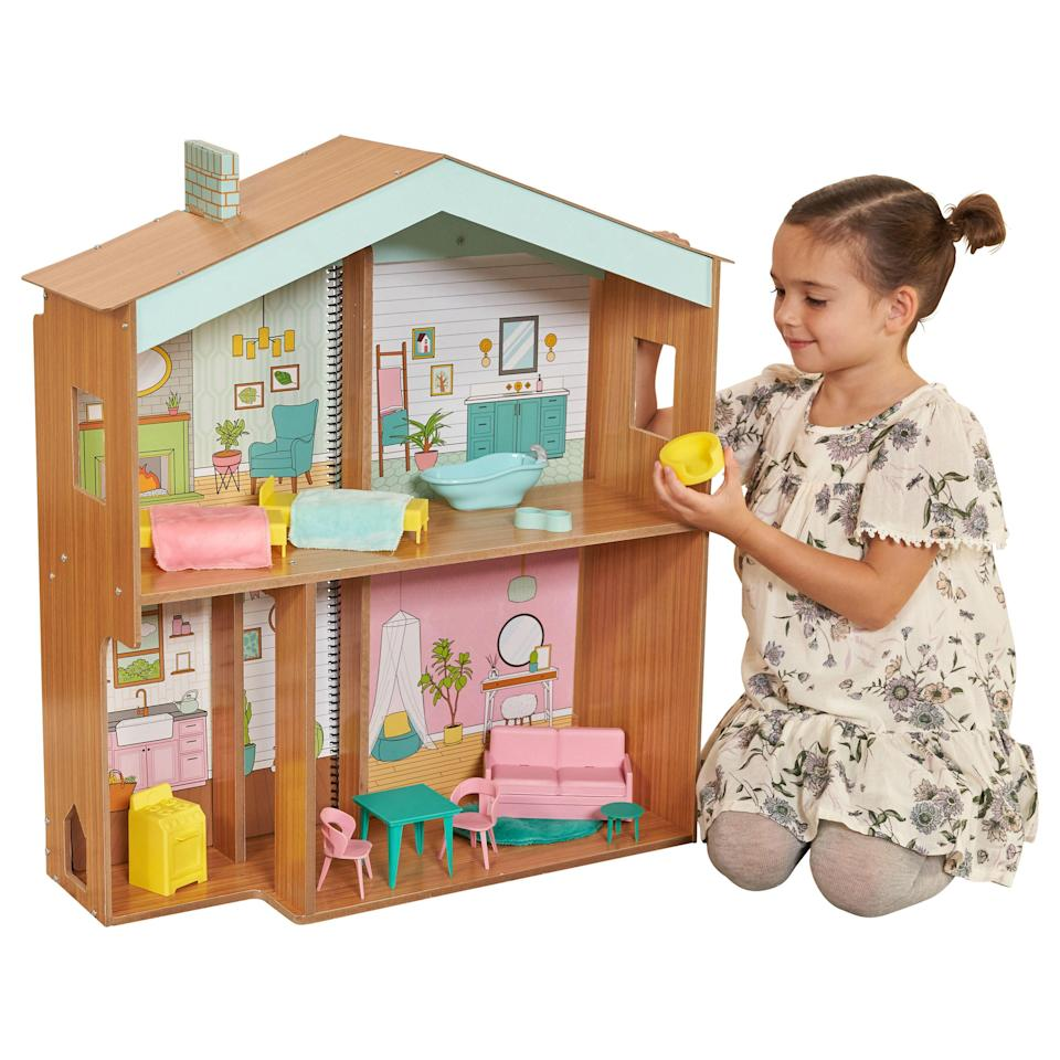 """<p><strong>KidKraft</strong></p><p>walmart.com</p><p><strong>$69.99</strong></p><p><a href=""""https://go.redirectingat.com?id=74968X1596630&url=https%3A%2F%2Fwww.walmart.com%2Fip%2F843446926&sref=https%3A%2F%2Fwww.womansday.com%2Flife%2Fg34428616%2Fnew-toys-2020%2F"""" rel=""""nofollow noopener"""" target=""""_blank"""" data-ylk=""""slk:SHOP NOW"""" class=""""link rapid-noclick-resp"""">SHOP NOW</a></p><p>Not only does this dollhouse offer five rooms where dolls can play, but it also includes a removeable coloring book and five felt markers where kids can design their own custom dream dollhouse anyway they want. <em>Ages 3+</em></p>"""