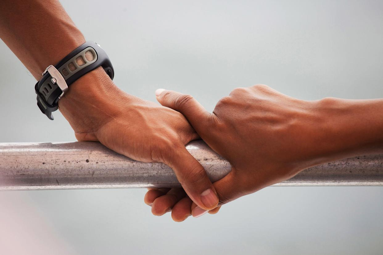Barack Obama and Michelle Obama's hands rest on the railing of a boat during a tour of St. Andrews Bay in Panama City Beach, Florida, on Aug. 15, 2010.
