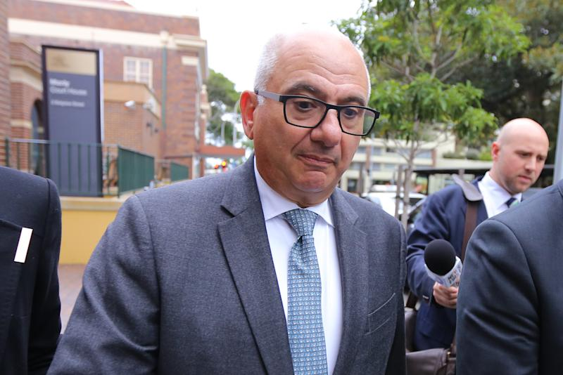 Stavros 'Steven' Economides is seen departing Manly Local Court in Sydney, Thursday, July 4, 2019. A former tax adviser has admitted he attacked a Liberal volunteer with a corkscrew in the final days of Tony Abbott's election campaign in northern Sydney. (AAP Image/Steven Saphore) NO ARCHIVING