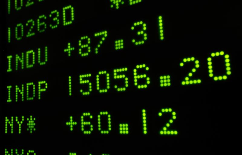 A board at the New York Stock Exchange Tuesday, May 7, 2013, shows the closing number for the Dow Jone industrial average. The DJIA punched through another milestone Tuesday: its first close above 15,000. (AP Photo/Richard Drew)