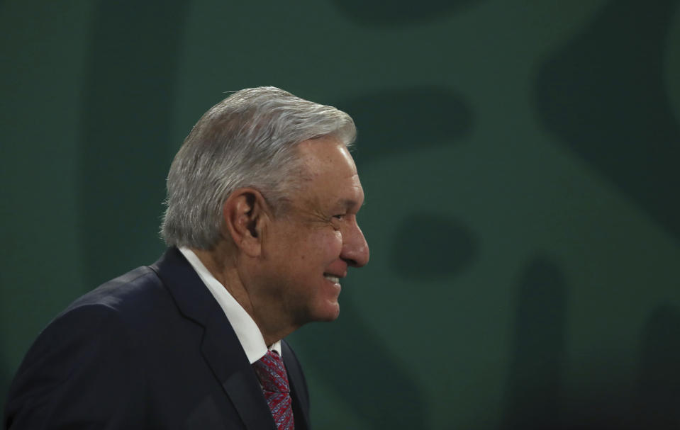 Mexican President Andrés Manuel López Obrador gives his daily morning press conference following a two-week absence after he tested positive for coronavirus, at the presidential palace, Palacio Nacional, in Mexico City, Monday, Feb. 8, 2021. (AP Photo/Marco Ugarte)