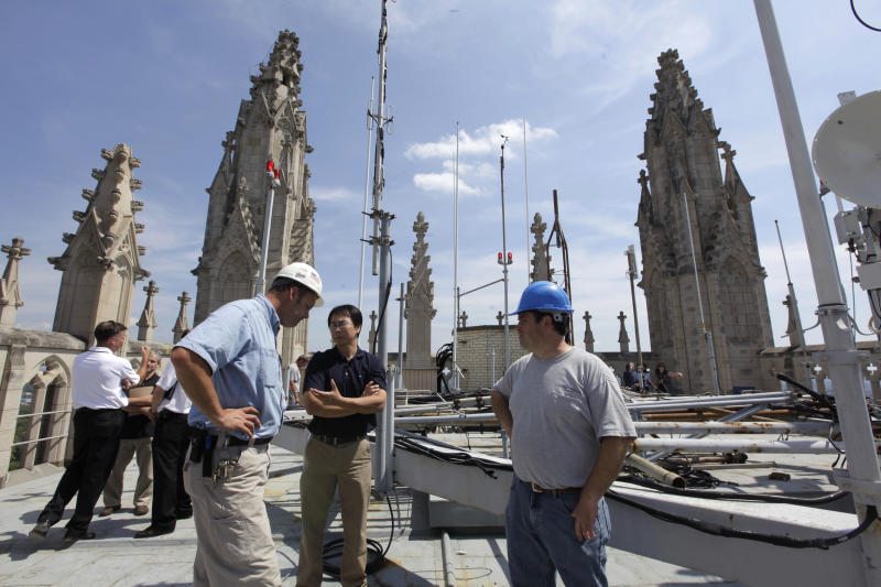 Stonemasons, engineers and other officials examine damage to the towers of the Washington National Cathedral in Washington, Wednesday, Aug. 24, 2011, after Tuesday's earthquake. A day after an earthquake rattled the nation's capital, officials begin assessing the damage to some of the city's oldest, and tallest, cultural landmarks including the National Cathedral and The Washington Monument. The monument remains closed after a crack was discovered at the top of the towering white obelisk on The National Mall.  (AP Photo/J. Scott Applewhite)