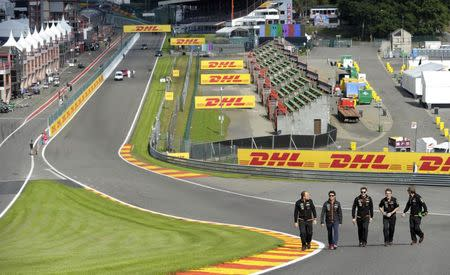 Force India Formula One driver Sergio Perez (2nd L) of Mexico walks with his staff on the track ahead of the weekend's Belgian Grand Prix in Spa-Francorchamps August 21, 2014. REUTERS/Laurent Dubrule