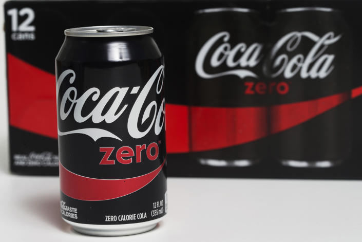 FILE- In this April 21, 2017, file photo, a can of Coca-Cola Zero Sugar is arranged for a photo in Surfside, Fla. Strong sales of water and sugar-free drinks powered third-quarter earnings for Coca-Cola Co reported Tuesday, Oct. 30, 2018. Coke said sales of Coca-Cola Zero Sugar saw double-digit percentage growth in North America. (AP Photo/Wilfredo Lee, File)