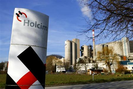 Holcim logo is pictured in front of the cement works in Eclepens near Lausanne