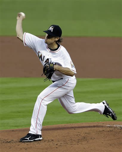 Miami Marlins' Kevin Slowey delivers a pitch during the first inning of a baseball game against the Atlanta Braves, Monday, April 8, 2013 in Miami. (AP Photo/Wilfredo Lee)