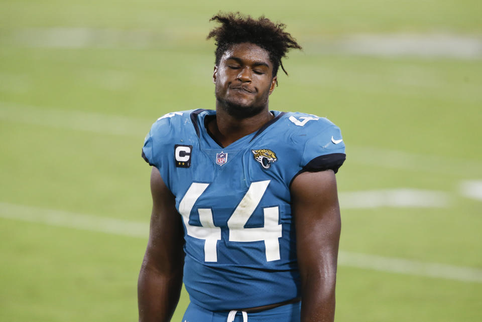 Jacksonville Jaguars middle linebacker Myles Jack (44) reacts after a Miami Dolphins touchdown while on the bench during the second half at TIAA Bank Field.