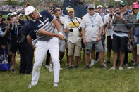 Bryson DeChambeau hits from the 11th fairway rough during the final round of the U.S. Open Golf Championship, Sunday, June 20, 2021, at Torrey Pines Golf Course in San Diego. (AP Photo/Marcio Jose Sanchez)