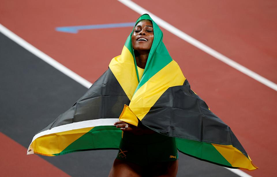 Tokyo 2020 Olympics - Athletics - Women's 100m - Final - OLS - Olympic Stadium, Tokyo, Japan - July 31, 2021. Gold medallist Elaine Thompson-Herah of Jamaica celebrates after winning REUTERS/Phil Noble     TPX IMAGES OF THE DAY