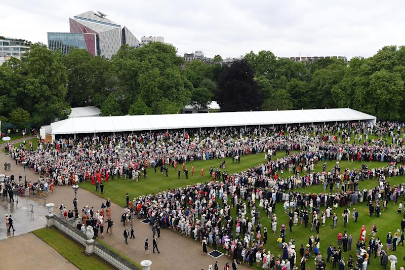 LONDON, ENGLAND - MAY 29: Guests gather on the lawn during the Queen's Garden Party at Buckingham Palace on May 29, 2019 in London, England. (Photo by Stuart C. Wilson - WPA Pool/Getty Images)