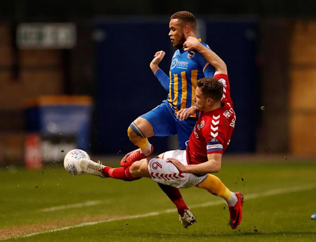 "Soccer Football - League One - Shrewsbury Town vs Charlton Athletic - Montgomery Waters Meadow, Shrewsbury, Britain - April 17, 2018 Shrewsbury Town's Carlton Morris in action with Charlton's Jason Pearce Action Images/Andrew Boyers EDITORIAL USE ONLY. No use with unauthorized audio, video, data, fixture lists, club/league logos or ""live"" services. Online in-match use limited to 75 images, no video emulation. No use in betting, games or single club/league/player publications. Please contact your account representative for further details. TPX IMAGES OF THE DAY"