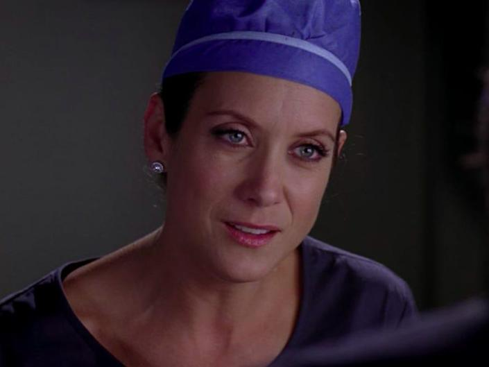 Kate Walsh as Addison on Greys Anatomy wearing a blue cap