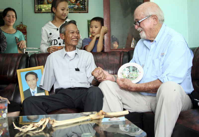 Dr. Sam Axelrad, right, shakes hands with former North Vietnamese soldier Nguyen Quang Hung at Hung's house in the town of An Khe, Gia Lai province, Vietnam on Monday July 1, 2013. In October 1966 Axelrad amputated Hung's arm after the soldier was shot in the arm in an ambush by American troops in the coastal province of Binh Dinh in the former South Vietnam. After decades of silence, the two veterans resumed contact after a Vietnamese journalist wrote an article in a newspaper last year about Axelrad's search for Hung, prompting Hung's brother in law to contact the newspaper's editors. (AP Photo/Thanh Nien Newspaper, Kha Hoa)