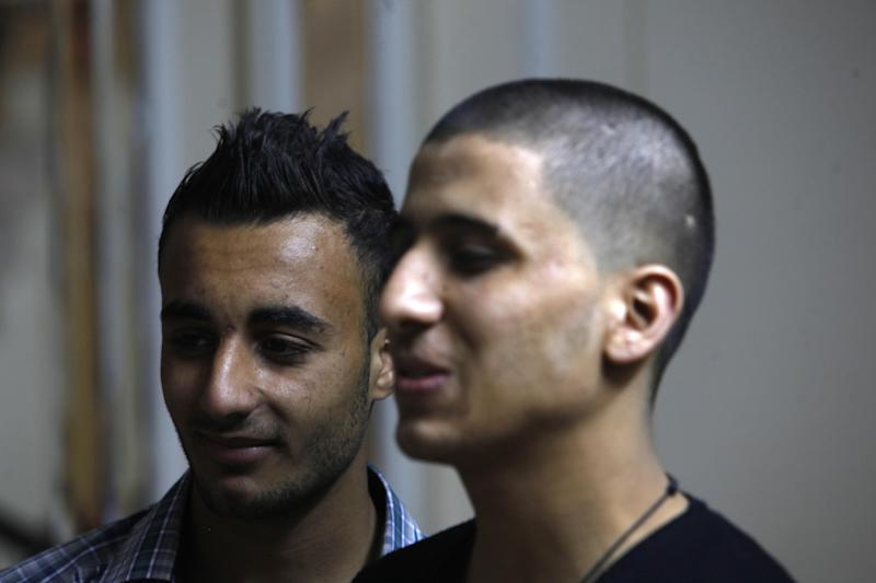 Ayman al-Sayed, 19, right, with his hair cut, stands with his friend Mohammed Hanouna, 18, left, in Gaza City, Sunday, April 7, 2013. Al-Sayed used to have shoulder-length hair but says he was grabbed by Hamas police in a sweep along with other young men with long or gel-styled spiky hair last week, and that police shaved everyone's head. Hanouna still wears the hair-style that can now get young men in trouble in Gaza, during the Islamic militants latest attempt to impose their hardline version of Islam on Gaza. (AP Photo/Adel Hana)