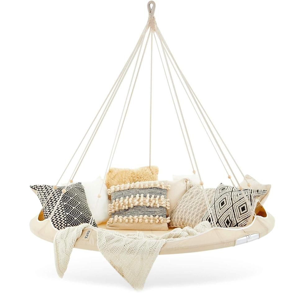 """<p><strong>Nested Porch Swings</strong></p><p>Nested Porch Swings</p><p><strong>$498.00</strong></p><p><a href=""""https://nestedporchswings.com/products/classic-large-tiipii-bed"""" rel=""""nofollow noopener"""" target=""""_blank"""" data-ylk=""""slk:Shop Now"""" class=""""link rapid-noclick-resp"""">Shop Now</a></p><p>A step up from a hammock: a floating bed. It'll feel like you're sleeping up in the clouds.</p>"""