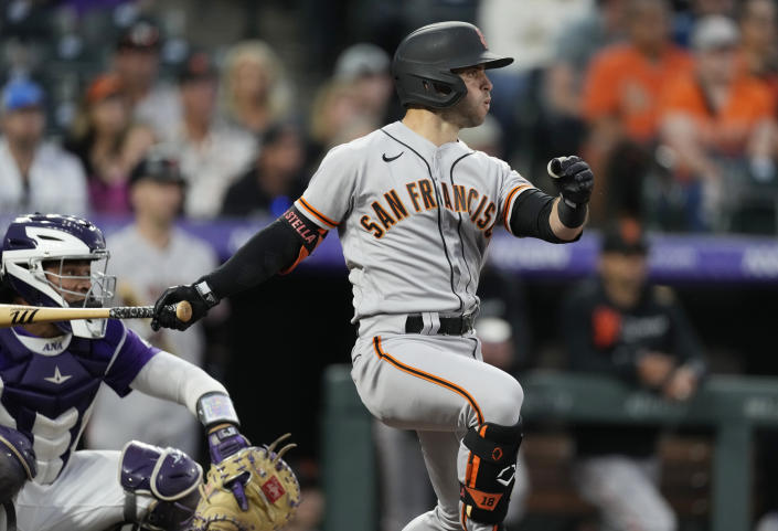 San Francisco Giants' Tommy La Stella singles off Colorado Rockies starting pitcher Peter Lambert in the third inning of a baseball game Friday, Sept. 24, 2021, in Denver. (AP Photo/David Zalubowski)