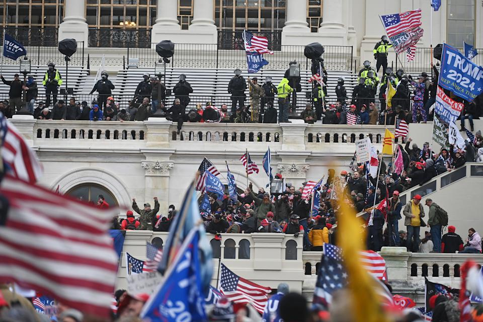 WASHINGTON, DC - JANUARY 06: Supporters of President Donald Trump take over balconies and inauguration scaffolding at the United States Capitol on Wednesday January 06, 2021 in Washington, DC. Pro-Trump supporters were gathering to protest last November's election results. (Photo by Matt McClain/The Washington Post via Getty Images)