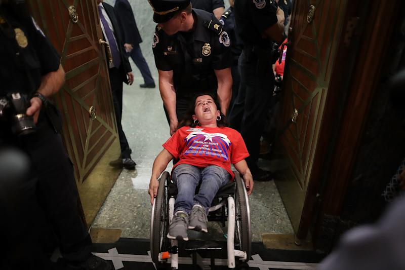 U.S. Capitol Police arrest activists from handicap advocacy organizations as protest during a Senate Finance Committee hearing about the proposed Graham-Cassidy Healthcare Bill in the Dirksen Senate Office Building on Capitol Hill September 25, 2017 in Washington, DC. (Chip Somodevilla via Getty Images)