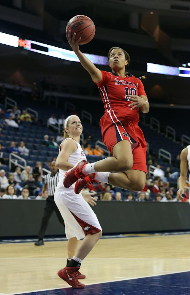 Mississippi guard Diara Moore (10) goes up for a basket as Arkansas guard Calli Berna (11) looks on in the first half of a first-round women's Southeastern Conference tournament NCAA college basketball game Wednesday, March 5, 2014, in Duluth, Ga. (AP Photo/Jason Getz