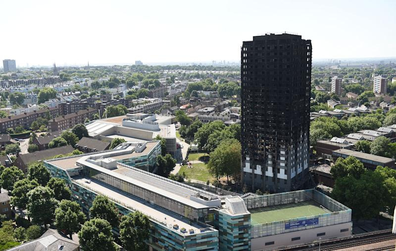 File photo dated 17/06/17 of Grenfell Tower in west London. The Grenfell Tower Inquiry's first report will not be published until October, months after survivors expected its release.