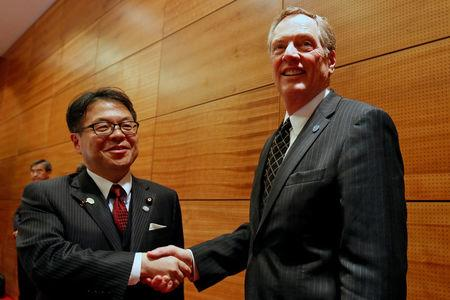 U.S. Trade Representative Robert Lighthizer and Japan's Trade Minister Hiroshige Seko pose for a photo during the APEC MRT 23 meeting in Hanoi
