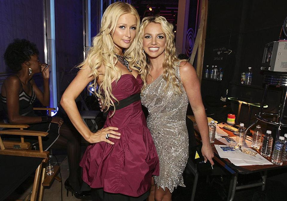 Paris Hilton and Britney Spears pose together while attending the VMAs in 2008.