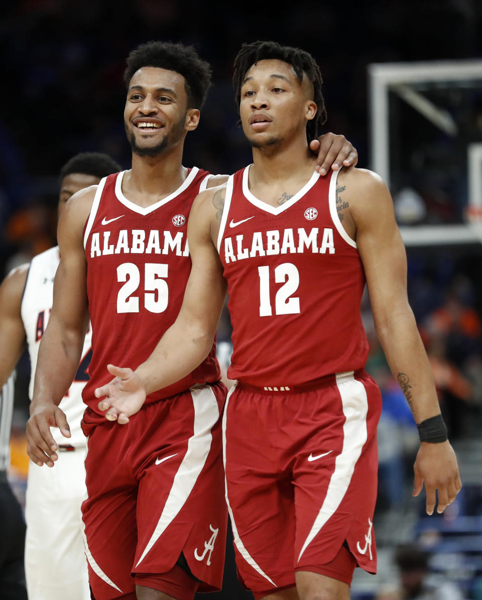Alabama's Braxton Key (25) and Dazon Ingram (12) celebrate during the second half in an NCAA college basketball quarterfinal game against Auburn at the Southeastern Conference tournament Friday, March 9, 2018, in St. Louis. Alabama won 81-63. (AP Photo/Jeff Roberson)