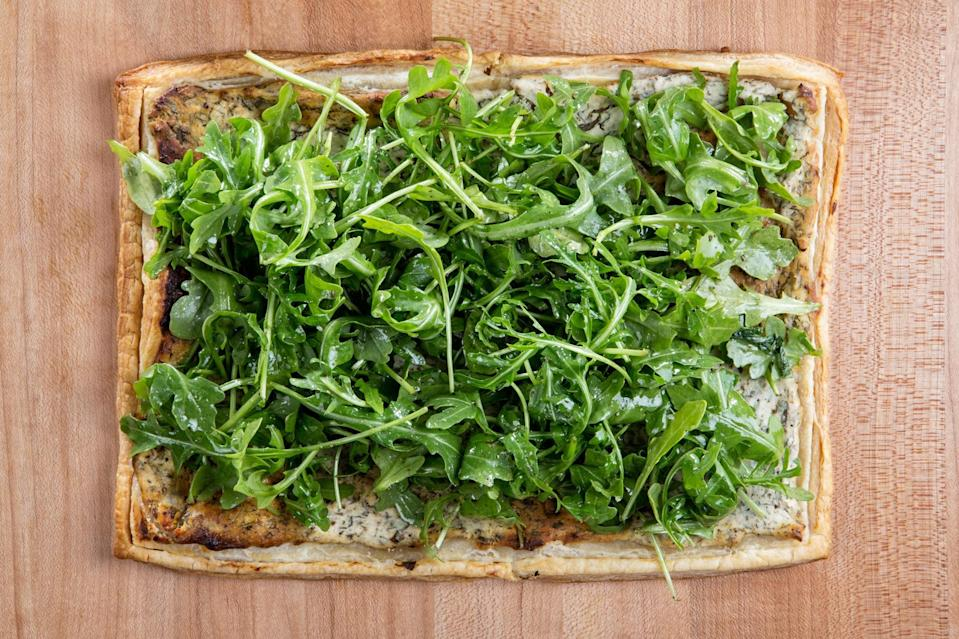 """<h1 class=""""title"""">Puff Pastry Herbed Goat Cheese and Arugula</h1> <div class=""""caption""""> <a href=""""https://www.epicurious.com/expert-advice/how-to-make-a-super-easy-spring-vegetable-tart-article?mbid=synd_yahoo_rss"""" rel=""""nofollow noopener"""" target=""""_blank"""" data-ylk=""""slk:Puff Pastry Tart with Herbed Cheese and Arugula"""" class=""""link rapid-noclick-resp"""">Puff Pastry Tart with Herbed Cheese and Arugula</a> </div> <cite class=""""credit"""">Photo by Chelsea Kyle, food styling by Katherine Sacks</cite>"""