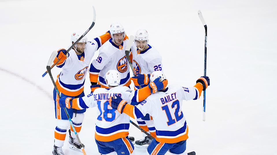 TORONTO, ONTARIO - AUGUST 07:  Brock Nelson #29 of the New York Islanders is congratulated by teammates Derick Brassard #10,Devon Toews #25,Josh Bailey #12 and Anthony Beauvillier #18 after Nelson scored in the second period against the Florida Panthers in Game Four of the Eastern Conference Qualification Round prior to the 2020 NHL Stanley Cup Playoffs at Scotiabank Arena on August 07, 2020 in Toronto, Ontario. (Photo by Andre Ringuette/Freestyle Photo/Getty Images)
