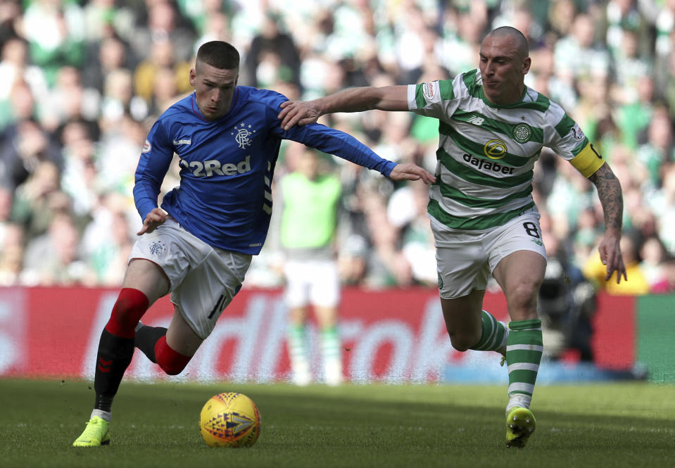 Rangers' Ryan Kent challenges with Celtic's Scott Brown, right, during their Scottish Premiership soccer match at Celtic Park in Glasgow, Scotland, Sunday March 31, 2019. (Andrew Milligan/PA via AP)
