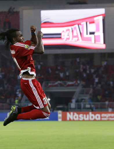 Equatorial Guinea's Javier Balboa jumps as he celebrates his goal during their African Cup of Nations Group A soccer match against Gabon in Bata, Equatorial Guinea, Sunday, Jan. 25, 2015. (AP Photo/Themba Hadebe)