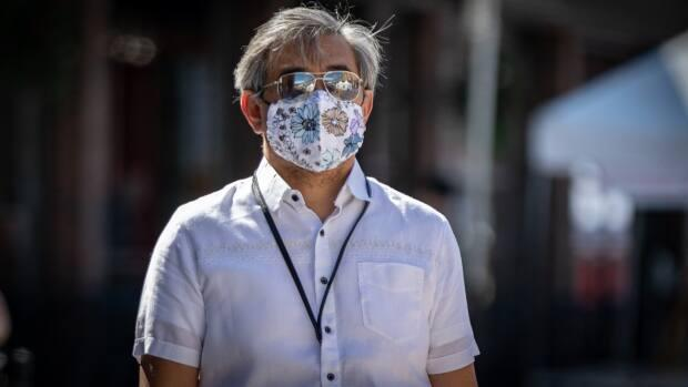 A person wears aviator sunglasses over a floral mask while walking in central Ottawa last week. On Sunday, public health officials in the nation's capital reported nine new cases of COVID-19. (Brian Morris/CBC - image credit)