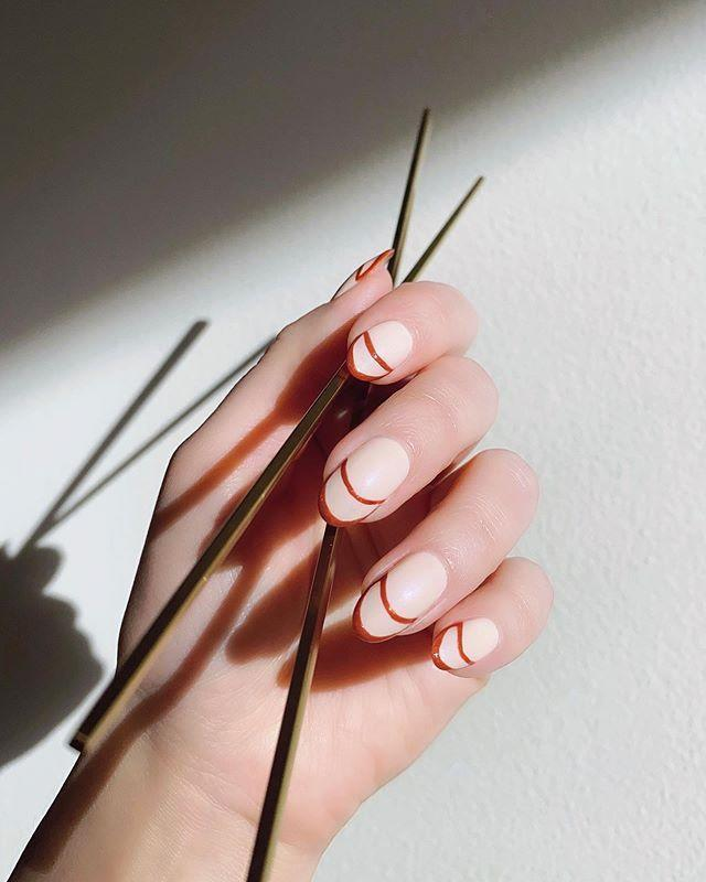 """<p>Accent a classic manicure with a striking double red French manicure. The finer the liner, the more modern it will look.</p><p>Emilie Heathe Public nail polish, $29,<a href=""""https://emilieheathe.com/products/nail-artist-by-emilie-heathe?variant=29445673353315"""" rel=""""nofollow noopener"""" target=""""_blank"""" data-ylk=""""slk:emilieheathe.com"""" class=""""link rapid-noclick-resp""""> emilieheathe.com</a>. <a class=""""link rapid-noclick-resp"""" href=""""https://emilieheathe.com/products/nail-artist-by-emilie-heathe?variant=29445673353315"""" rel=""""nofollow noopener"""" target=""""_blank"""" data-ylk=""""slk:SHOP"""">SHOP</a></p><p><a href=""""https://www.instagram.com/p/B9pQoRJFkhi/"""" rel=""""nofollow noopener"""" target=""""_blank"""" data-ylk=""""slk:See the original post on Instagram"""" class=""""link rapid-noclick-resp"""">See the original post on Instagram</a></p>"""