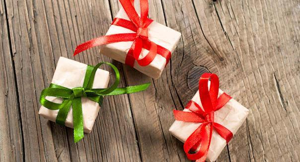 Gift boxes on old wooden background