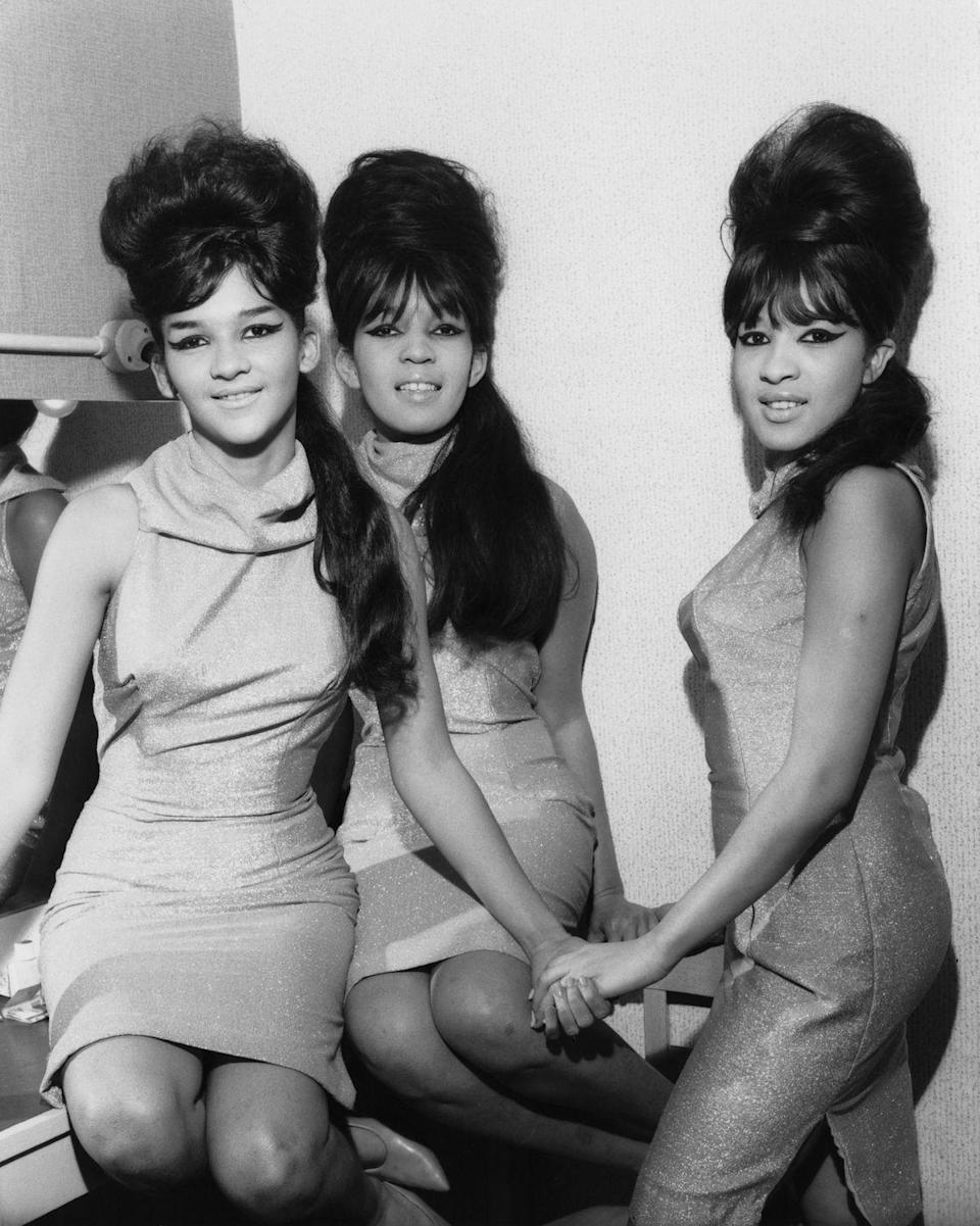 <p>Women saw the likes of the Ronettes and Brigitte Bardot piling hair atop their heads to reach as much height as possible.</p>