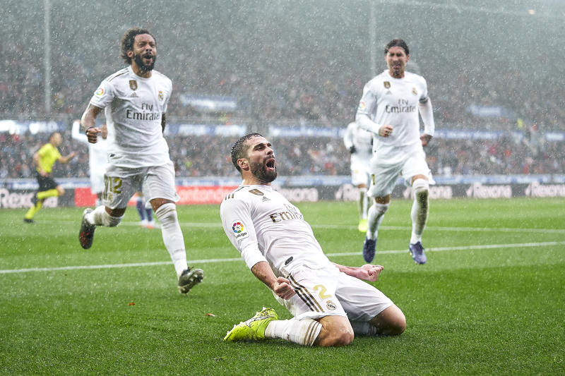 VITORIA-GASTEIZ, SPAIN - NOVEMBER 30: Daniel Carvajal of Real Madrid CF celebrates their team's second goal during the Liga match between Deportivo Alaves and Real Madrid CF at Estadio de Mendizorroza on November 30, 2019 in Vitoria-Gasteiz, Spain. (Photo by Quality Sport Images/Getty Images)