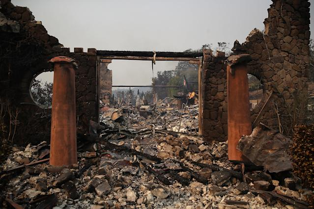 <p>The remains of the fire damaged Signarello Estate Winery after an out of control wildfire moved through the area on Oct. 9, 2017 in Napa, Calif. Tens of thousands of acres and hundreds of homes and businesses have burned in widespread wildfires that are burning in Napa and Sonoma counties. (Photo: Justin Sullivan/Getty Images) </p>