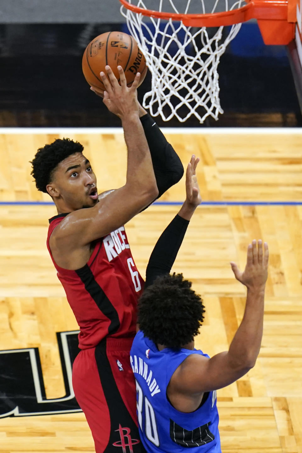 Houston Rockets forward KJ Martin, left, takes a shot over Orlando Magic guard Devin Cannady during the first half of an NBA basketball game, Sunday, April 18, 2021, in Orlando, Fla. (AP Photo/John Raoux)