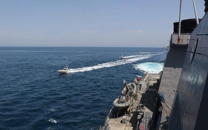 Iranian Islamic Revolutionary Guard Corps Navy (IRGCN) vessels conducted unsafe and unprofessional actions against US Military ships by crossing the ships' bows and sterns at close range. - EPA