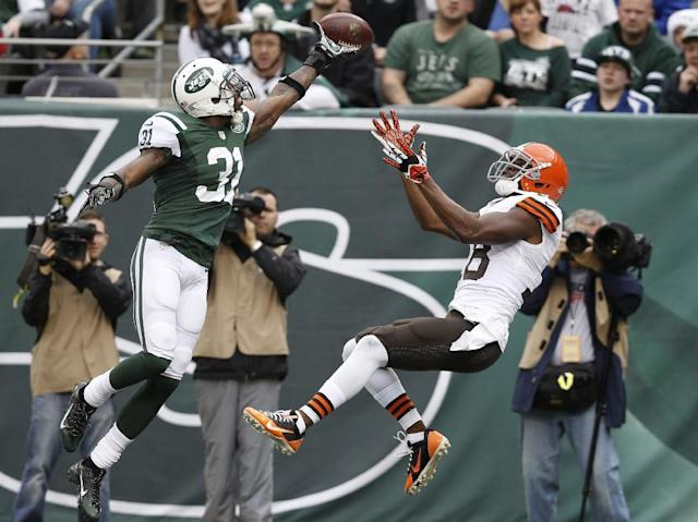 New York Jets cornerback Antonio Cromartie (31) deflects a pass to Cleveland Browns' Greg Little (18) in the end zone during the first half of an NFL football game on Sunday, Dec. 22, 2013, in East Rutherford, N.J. (AP Photo/Kathy Willens)