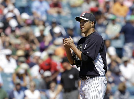 New York Yankees starting pitcher Hiroki Kuroda reacts on the mound after allowing a 3-run home run to the Philadelphia Phillies in the fourth inning of a spring training baseball game at Steinbrenner Field in Tampa, Fla., Saturday, March 16, 2013. (AP Photo/Kathy Willens)