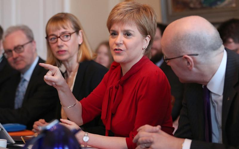 Leslie Evans (second left) is under pressure to investigate an £8 million announcement for Glasgow - PA