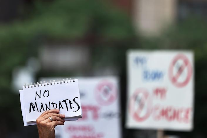 People gather in New York City on Aug. 9. 2021, to protest vaccine mandates.